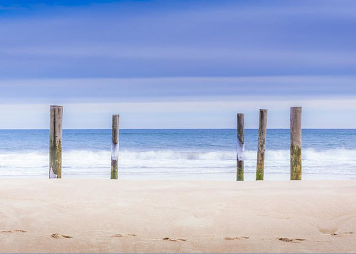 Main Beach Greeting Card featuring the photograph Main Beach Pilings by Ryan Moore