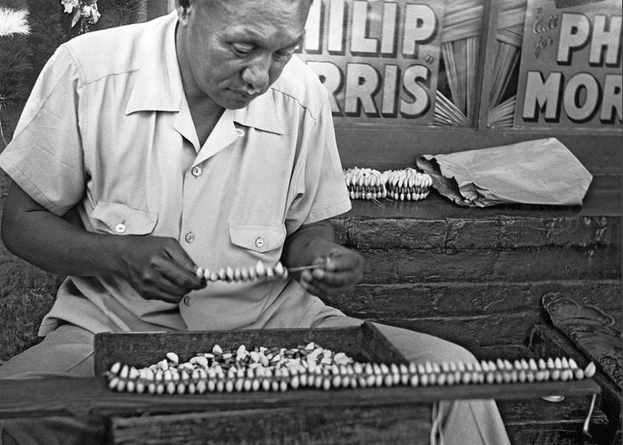 1948 Greeting Card featuring the photograph Making Puka Shell Necklaces by Underwood Archives
