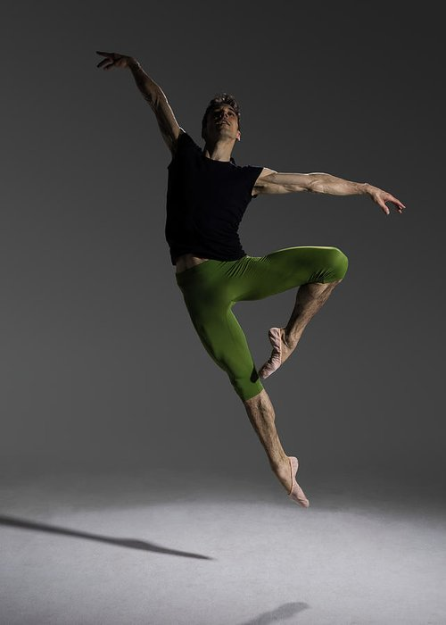 Ballet Dancer Greeting Card featuring the photograph Male Ballet Dancer Jumping In Passé by Nisian Hughes