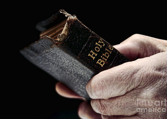 Man Greeting Card featuring the photograph Man Hands Holding Old Bible by Olivier Le Queinec