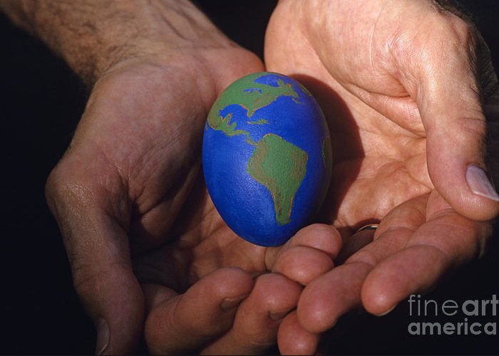 Carry Greeting Card featuring the photograph Man Holding Earth Egg by Jim Corwin