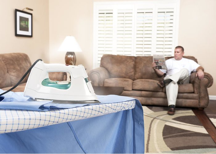 Iron Greeting Card featuring the photograph Man Ironing Shirt by Joe Belanger