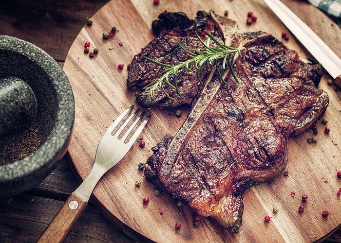 Rosemary Greeting Card featuring the photograph Medium Roasted T-bone Steak by Gmvozd