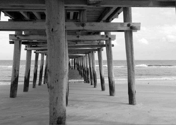 Sea Greeting Card featuring the photograph Meet Me Under The Pier. by Katie Hill