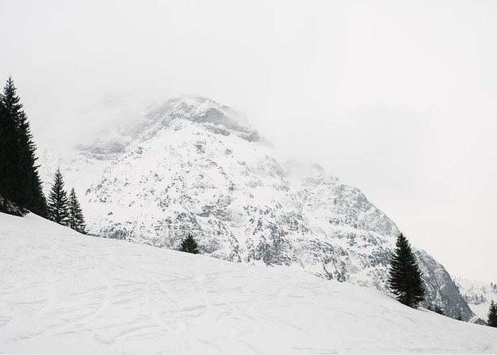 Minimalism Greeting Card featuring the photograph Minimalist Snow Landscape - Mountain And Trees In Winter by Matthias Hauser