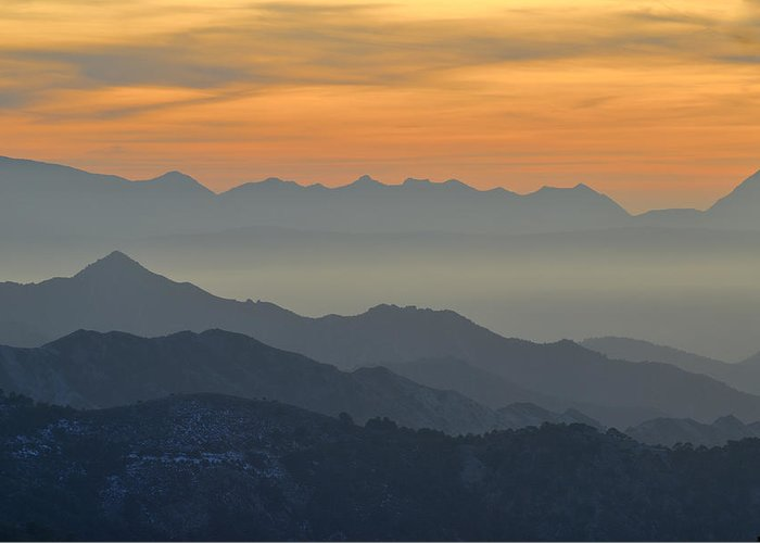 Sunset Greeting Card featuring the photograph Mists In The Mountains At Sunset by Guido Montanes Castillo