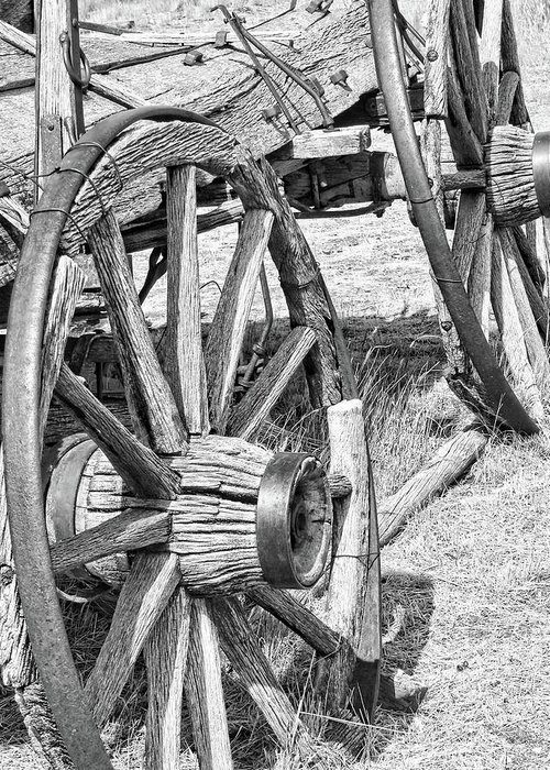 Wheel Greeting Card featuring the photograph Montana Old Wagon Wheels Monochrome by Jennie Marie Schell