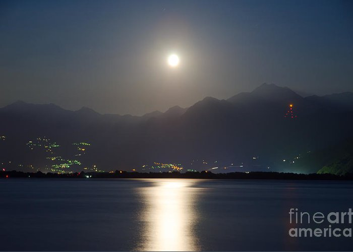 Moon Light Greeting Card featuring the photograph Moon Light Over A Lake by Mats Silvan