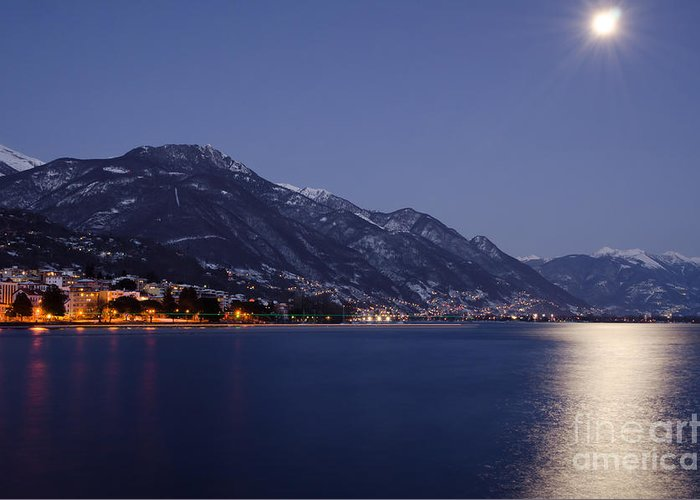 Moon Greeting Card featuring the photograph Moonlight Over A Lake by Mats Silvan