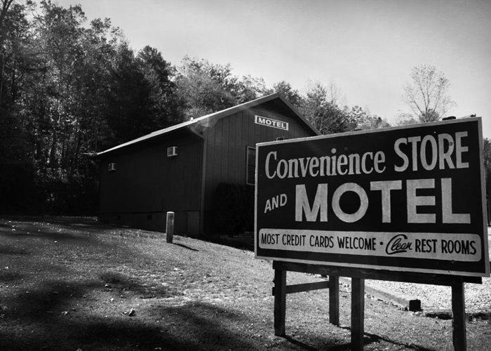 Kelly Hazel Greeting Card featuring the photograph Motel Sign In Black And White by Kelly Hazel