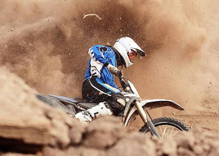 Crash Helmet Greeting Card featuring the photograph Motocross Biker Taking A Turn In The by Daniel Milchev