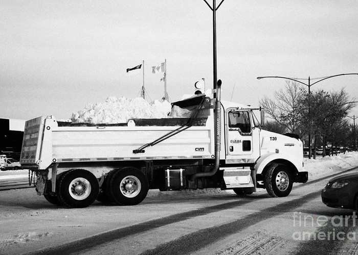 Downtown Greeting Card featuring the photograph municipal city dump truck taking away snow cleared from parking lots and roads in Saskatoon Saskatch by Joe Fox