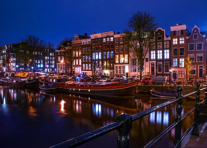 Amsterdam Greeting Card featuring the photograph Night Lights On The Amsterdam Canals. Holland by Jenny Rainbow