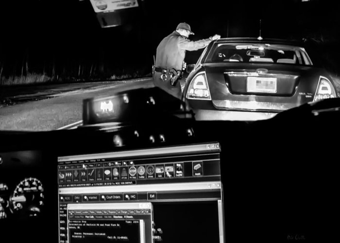 Police Greeting Card featuring the photograph Night Traffic Stop by Bob Orsillo