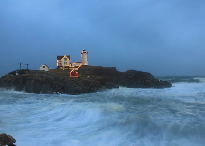 Maine Lighthouse Greeting Card featuring the photograph Nubble Lighthouse High Surf And Holiday Lights by John Burk