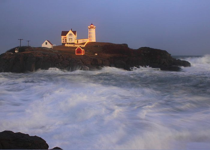Maine Greeting Card featuring the photograph Nubble Lighthouse Holiday Lights And High Surf by John Burk