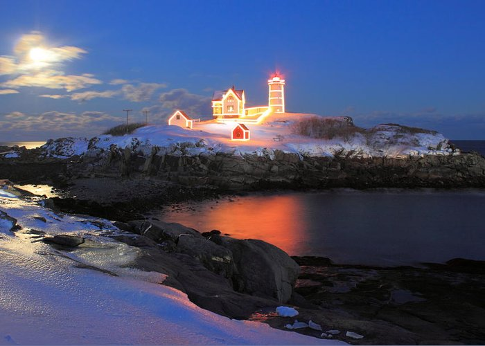 Nubble Lighthouse Greeting Card featuring the photograph Nubble Lighthouse Holiday Lights And Winter Moon by John Burk