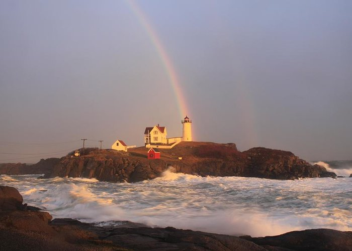 Lighthouse Greeting Card featuring the photograph Nubble Lighthouse Rainbow And High Surf by John Burk