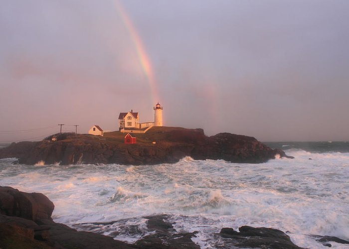 Lighthouse Greeting Card featuring the photograph Nubble Lighthouse Rainbow And Surf At Sunset by John Burk
