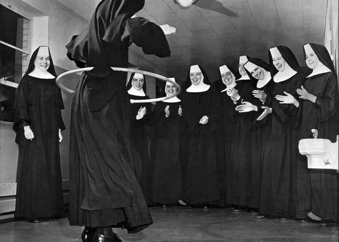 1958 Greeting Card featuring the photograph Nun Swivels Hula Hoop On Hips by Underwood Archives