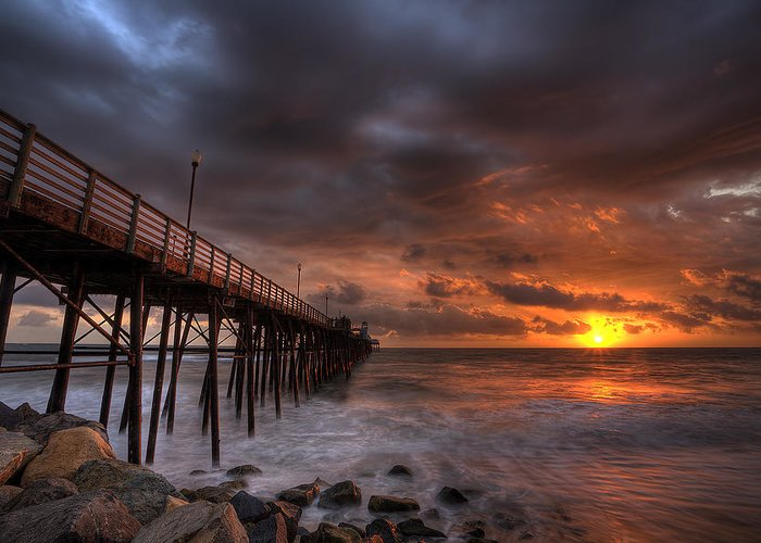 Sunset Greeting Card featuring the photograph Oceanside Pier Perfect Sunset by Peter Tellone