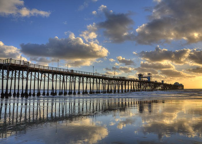 California Greeting Card featuring the photograph Oceanside Pier Sunset Reflection by Peter Tellone