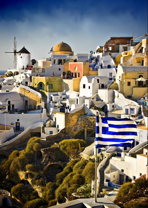 Santorini Greeting Card featuring the photograph Oia And A Greek Flag by Meirion Matthias