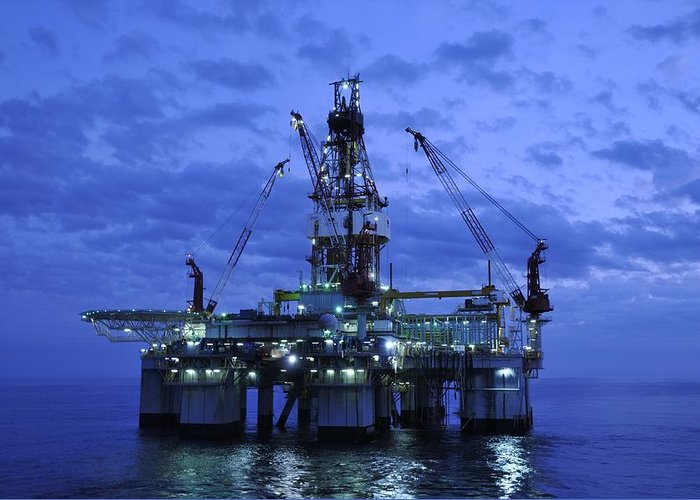 Oil Rig Greeting Card featuring the photograph Oil Rig At Twilight by Bradford Martin