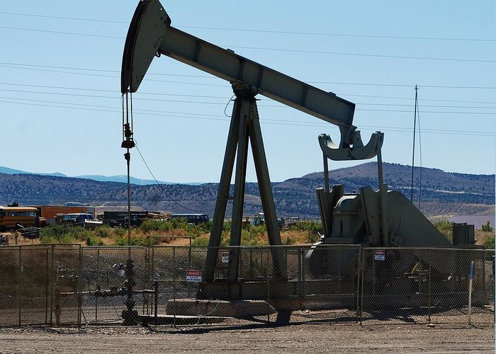 Oil Well Greeting Card featuring the photograph Oil Well Pumper by Dany Lison