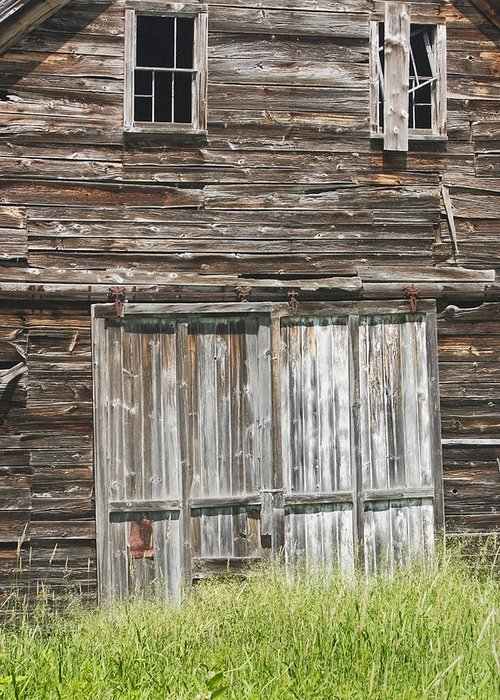 Barn; Building; Old; Old Barn; Maine; Abandoned; Maine Barns; Old Building; Obsolete; Beaten Up; Farm; Old Buildings Maine; Old Door; Weathered Door; Country Living; Farming; Building Exterior; Architecture; Shed; Wood Shingles; Structure; Window; Door; Weathered; Country; Rural; Rustic; Grass; Sunny; Wood; Siding; Spring; New England; Maine Buildings; Old Barns; Rustic Building; Abandoned Buildings Greeting Card featuring the photograph Old Barn In Maine by Keith Webber Jr