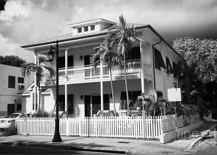 Old Greeting Card featuring the photograph Old Historic Wooden Two Storey Building With White Picket Fence Key West Florida Usa by Joe Fox