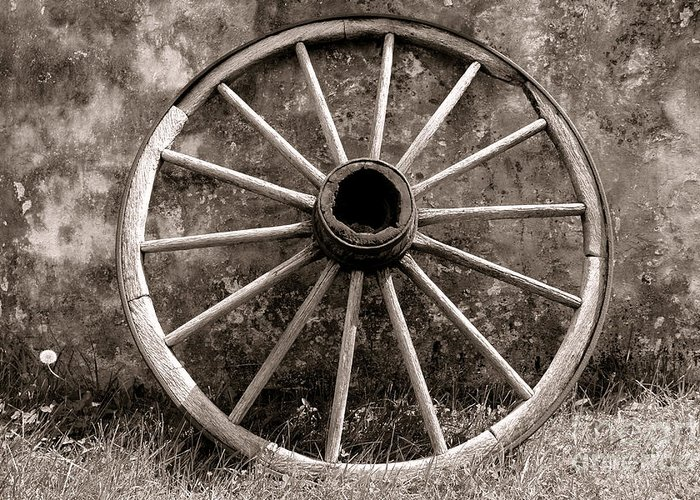 Wagon Greeting Card featuring the photograph Old Wagon Wheel by Olivier Le Queinec