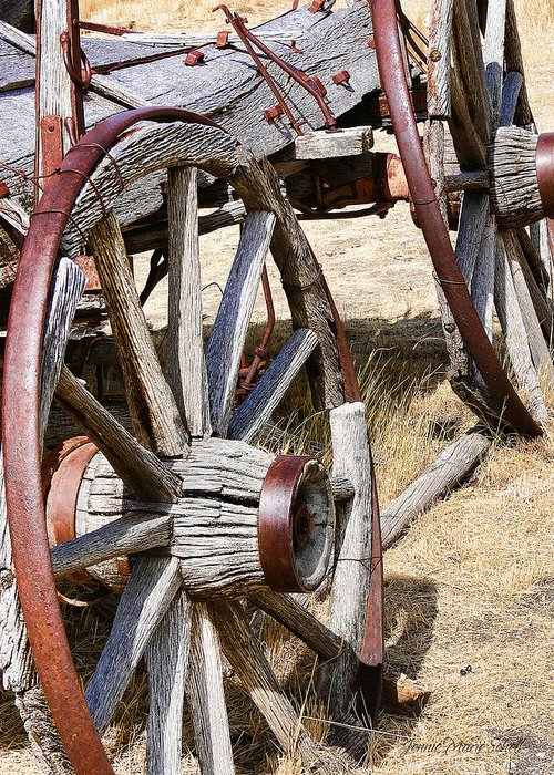 Wheel Greeting Card featuring the photograph Old Wagon Wheels From Montana by Jennie Marie Schell