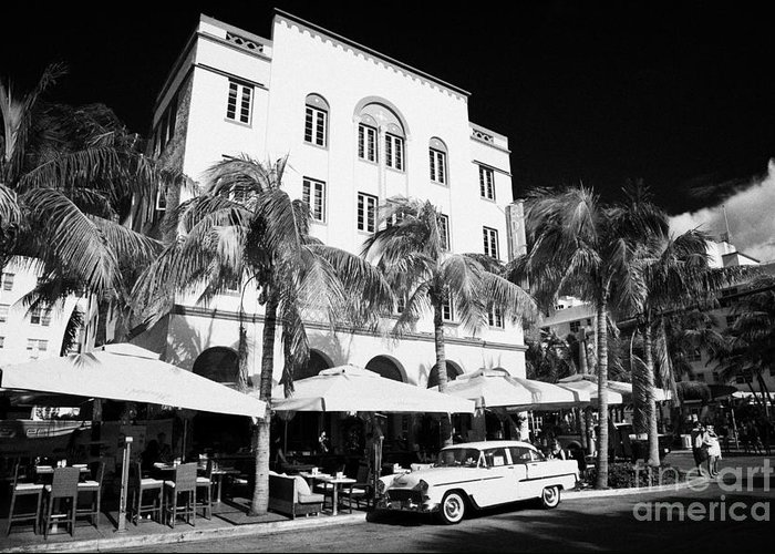 Orange Greeting Card featuring the photograph Orange Chevrolet Bel Air In The Cuban Style Outside The Edison Hotel by Joe Fox