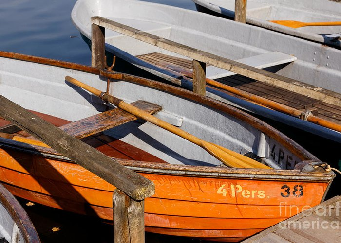 Afternoon Greeting Card featuring the photograph Orange Rowboat by Jannis Werner