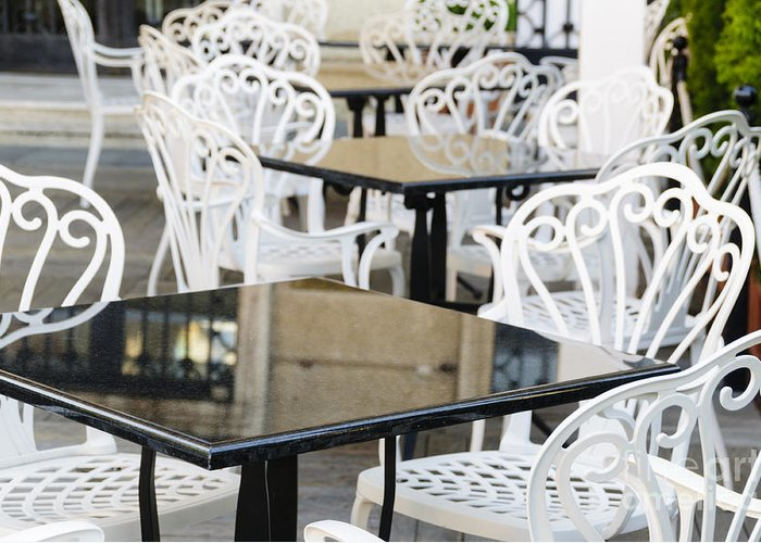 Black Greeting Card featuring the photograph Outdoor Cafe Tables by Oscar Gutierrez