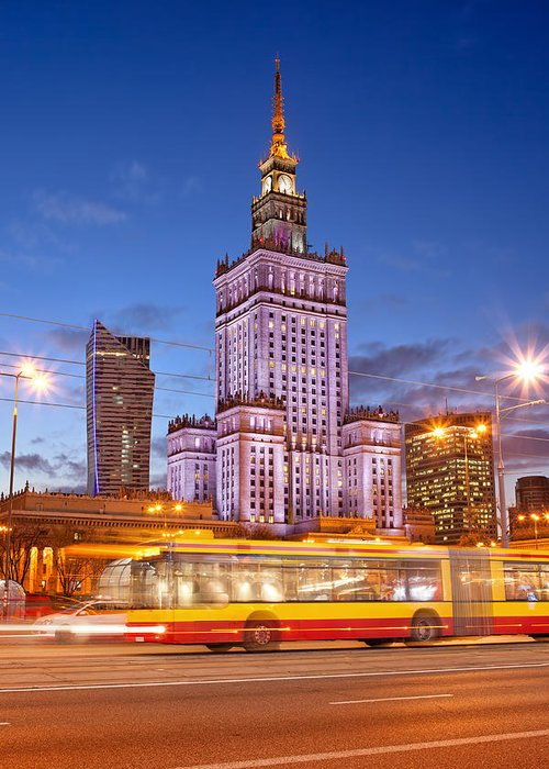 Warsaw Greeting Card featuring the photograph Palace Of Culture And Science In Warsaw At Dusk by Artur Bogacki