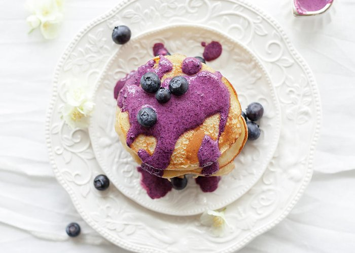 Temptation Greeting Card featuring the photograph Pancakes With Blueberry Sauce by Ingwervanille