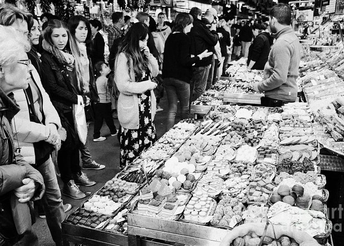 Food Greeting Card featuring the photograph people buying chocolates on display inside the la boqueria market in Barcelona Catalonia Spain by Joe Fox