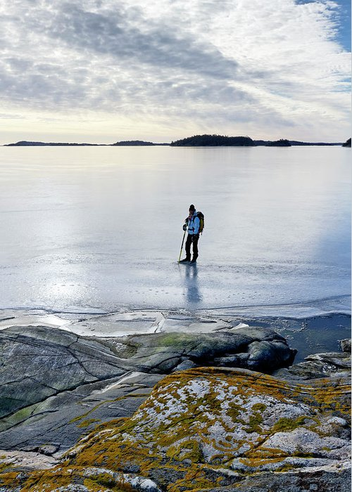 Archipelago Greeting Card featuring the photograph Person Skating At Frozen Sea by Johner Images