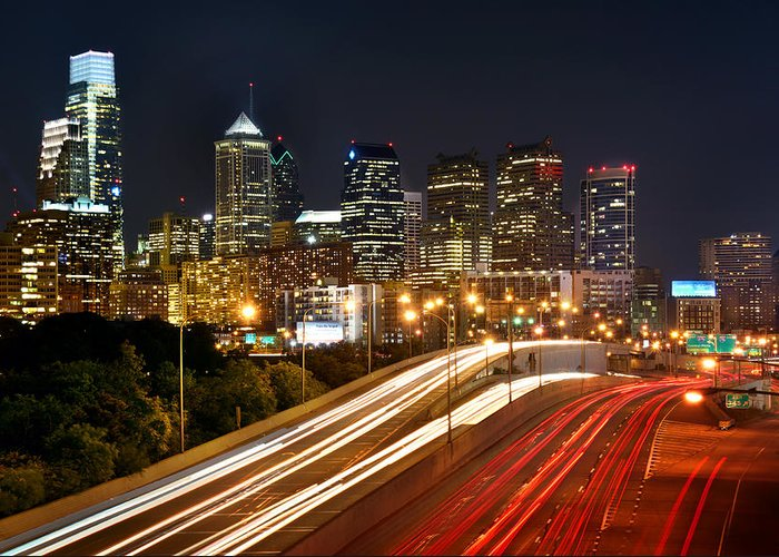 Philadelphia Skyline At Night Greeting Card featuring the photograph Philadelphia Skyline At Night In Color Car Light Trails by Jon Holiday