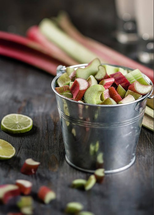 Bucket Greeting Card featuring the photograph Pieces Of Rhubarb In Metal Bucket And by Westend61