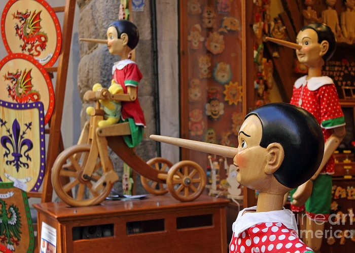 Marionette Greeting Card featuring the photograph Pinocchio Inviting Tourists In Souvenirs Shop by Kiril Stanchev