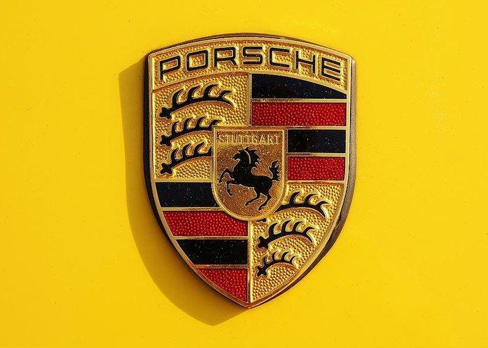 Yellow Porsche Logo Greeting Card featuring the photograph Porsche by Bradley Dixon