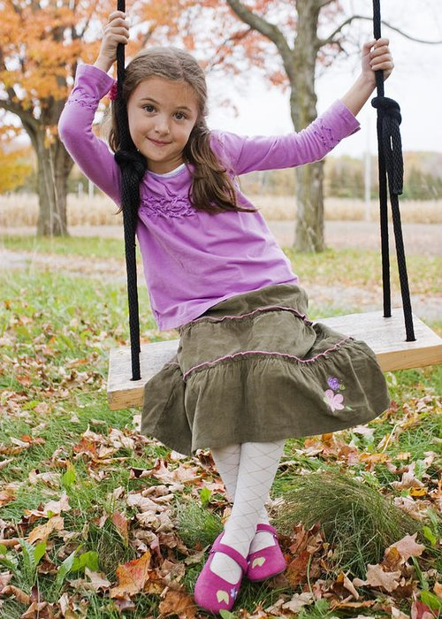 Light Greeting Card featuring the photograph Portrait Of Young Girl On Swing by Vast Photography