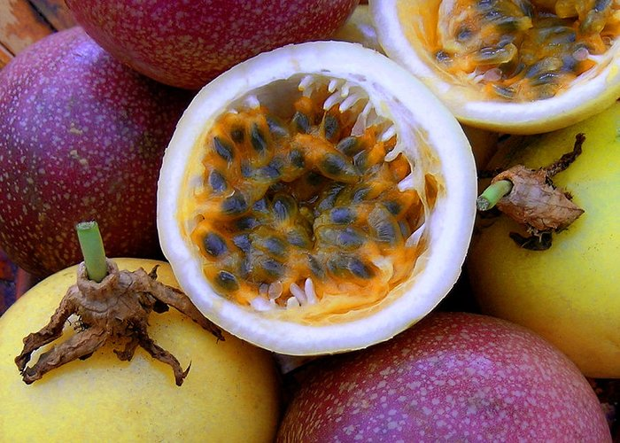 Passion Fruit Greeting Card featuring the photograph Purple And Yellow Passion Fruit by James Temple