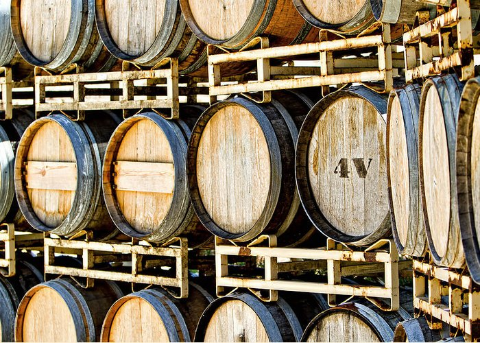 Aging Greeting Card featuring the photograph Rack Of Old Oak Wine Barrels by Susan Schmitz