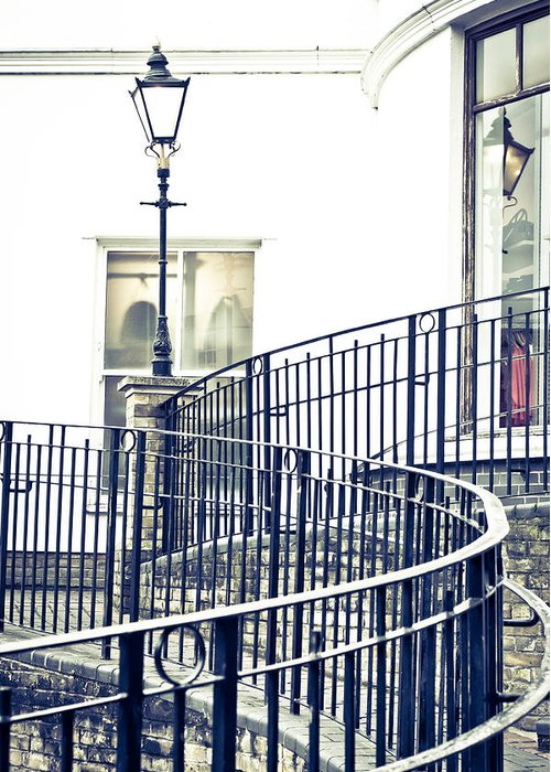 Alley Greeting Card featuring the photograph Railings And Lamp by Tom Gowanlock