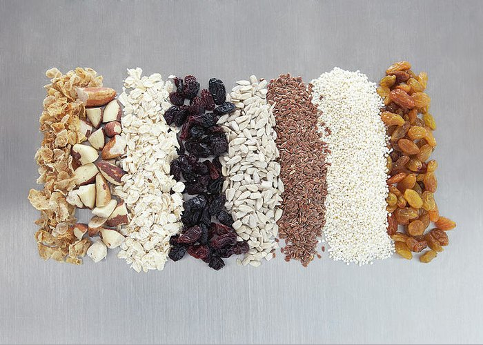 Nut Greeting Card featuring the photograph Raw Nuts, Dried Fruit And Grains by Laurie Castelli