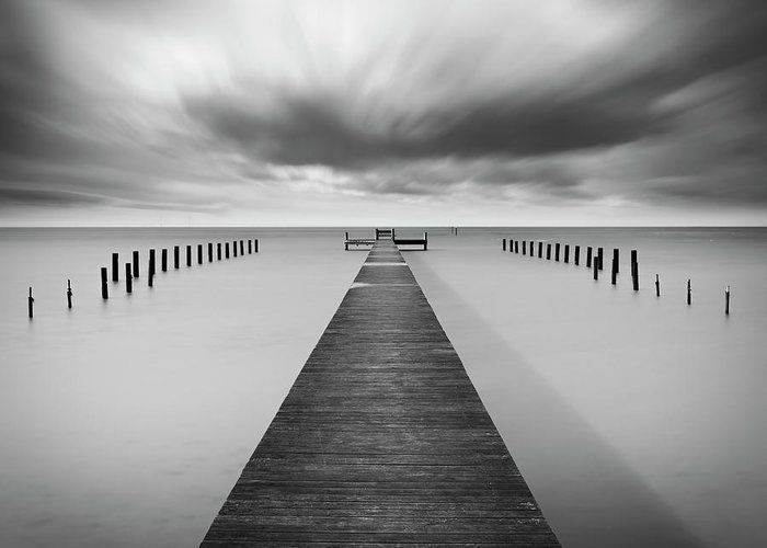 Pier Greeting Card featuring the photograph Reaching Out by Mats Reslow